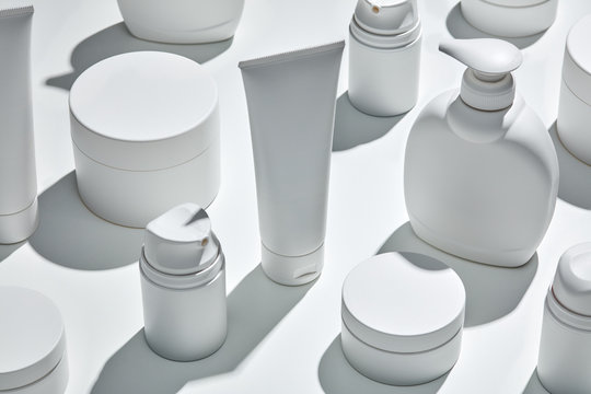 White containers from creams and lotions.