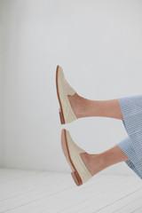 Crop woman legs in shoes