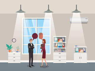 business couple talking in corridor office