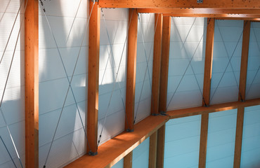 Architectural detail of a beautiful modern combination of wood and white panels
