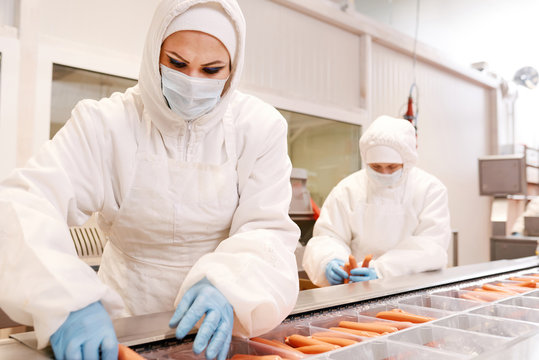 Sausage packaging at meat plant