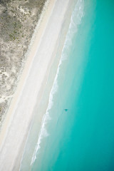 Aerial view of blue waters and sandy beach