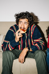 Man sitting and eating pizza