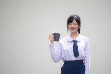 asia thai high school student uniform beautiful girl drinking hot drink