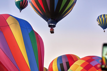 Bunch of hot air balloons taking off