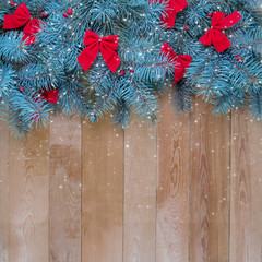 .Christmas fir tree with decorations on a wooden snowy background