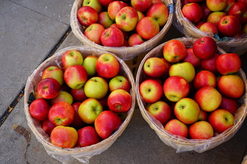 Baskets of fresh apples at a farmers market