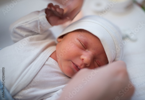 close up portrait of adorable baby wearing hat