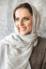 Smiling woman in headscarf