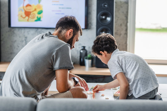 Dad and Son Playing at Home
