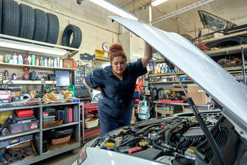 Female Mechanic Working on Cars in Her Shop