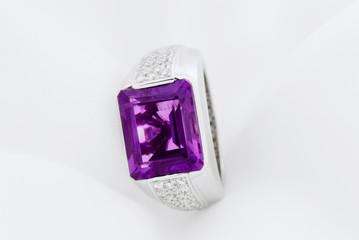White Gold Ring With Amethyst And Diamonds On Soft White Background