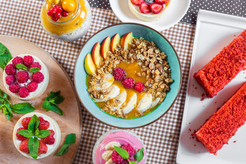 Porridge of muesli with fruit. Fresh fruit in porridge. Muesli with fruits. Muesli with fruit puree.