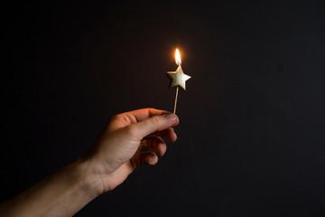 burning star-shaped candle