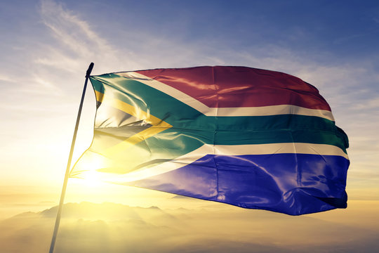 South Africa african flag textile cloth fabric waving on the top sunrise mist fog