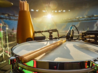 Drum on stage. concerts Musical instruments. Show. Musical accompaniment. Drumsticks lie on the drum. Music.
