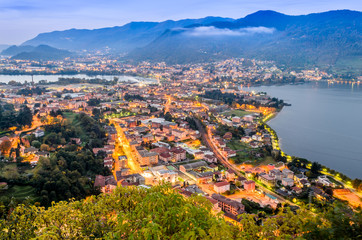 City lights at down. A panorama on the Adda river during the sunrise. Picture taken from Somasca in Vercurago - Lecco