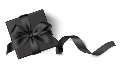 Decorative black gift box with black bow and long ribbon isolated on white background. Top view. Vector illustration.