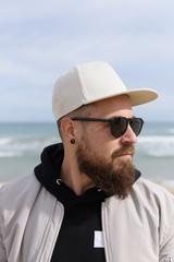 Bearded man at seaside