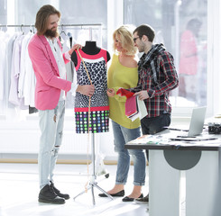 tailor and designer working with a woman client in the Studio
