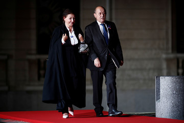 French Foreign Affairs Minister Jean-Yves Le Drian and his wife Maria Vadillo arrive to attend a visit and a dinner at the Orsay Museum in Paris