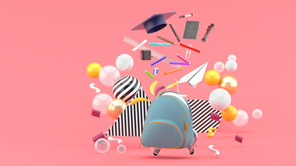 School Supplies Floating out of a school bag amidst colorful balls on a pink background.-3d render..