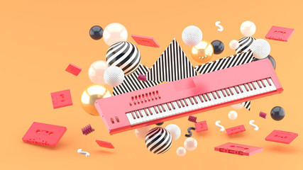Reed piano keyboard and red tape amidst colorful balls on an orange background.-3d render..