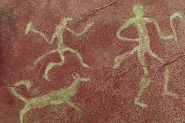 image of ancient people and animals on the cave wall. history of antiquities.