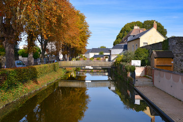 The Huisne river with reflection at La-Ferté-Bernard, a commune in the Sarthe department in the Pays de la Loire region in north-western France.