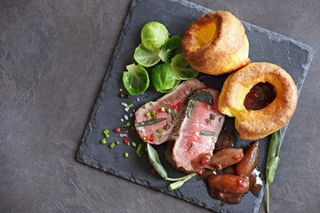 Roast beef with yorkshire pudding, brussels sprouts and shallots. Traditional british roast beef. Overhead view