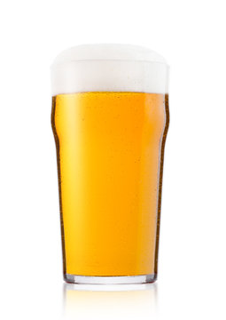 Cold glass of lager ale beer with foam and dew