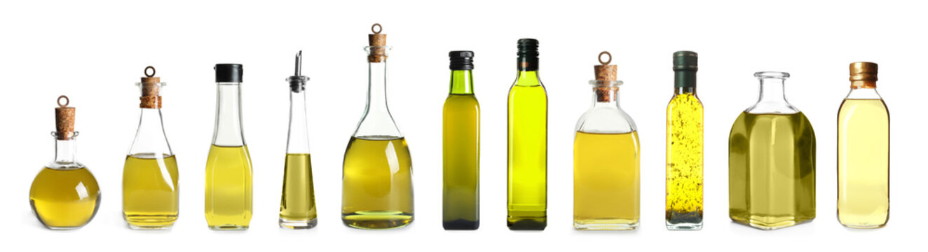 Set with bottles of oil on white background