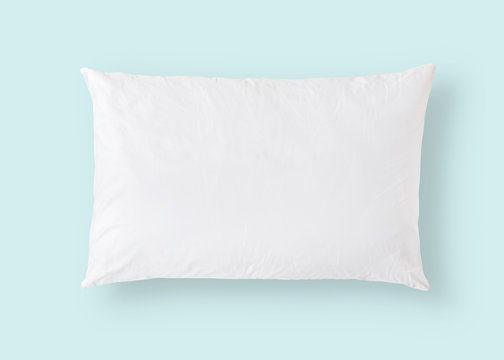 White pillow on blue background isolated with clipping path for bedding mockup design template