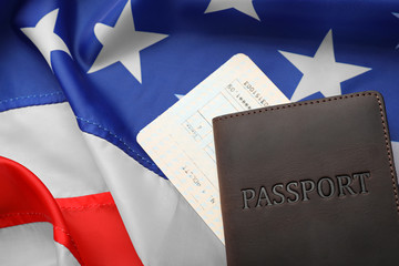 Passport and ticket on flag of USA