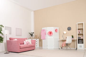 Cozy child room interior with sofa, study station and modern decor elements