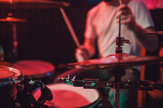 Professional drum set closeup. Drummer with drums, live music concert.
