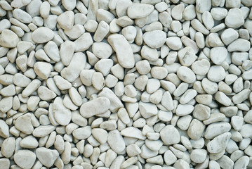 White pebbles stone texture background with copy space