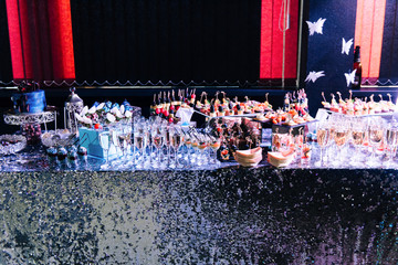 Delicious decorated sweet bar with snacks and champagne for wedding Banquet. Sweet an unusual reception for the newlyweds and guests