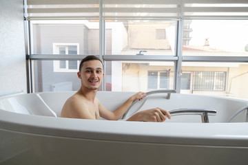 Patient doing some special exercises under supervision of physical therapist in a therapy bath tub