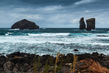 Three volcanic rocks at Mosteiros beach (praia Mosteiros) in bad weather Sao Miguel, Azores