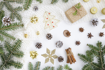 New year Christmas background with gifts, pine branches, toys, cones, candle, snowflakes, fir branches on white background. Flat lay, top view winter background