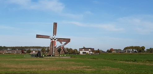 Old historical windmills in the Doespolder at Hoogmade in the Netherlands running with sails on its wings