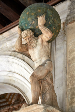 historic atlas statue carrying world on shoulders