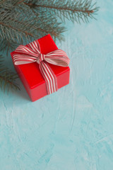 Red Christmas gift box on blue a background