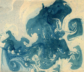 Stains of paint on paper. The texture of the splashes and spots of paint. EBRU- Ancient oriental drawing technique. Chaotic abstract organic design. Marbleized.