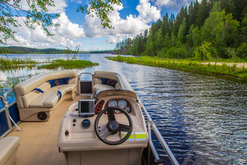 Boat trips. Lake. Powerboat for walking. Boat rental. Rest in the summer. Sunny day.