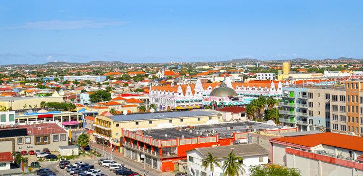 Oranjestad, Aruba. View from above of colourful buildings in Oranjestad on the island of Aruba. Blue sky day.