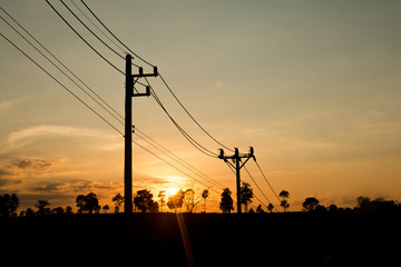 an old Power pole with line on Silhouette environment, High level of noise. sun rise or sun set time Wall mural