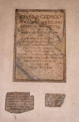 Milan, Lombardy, Italy. Memorial plaque on the wall of the Basilica of Sant'Ambrogio. In the church of Sant Ambrogio there are relics of St. Ambrose of Milan and the martyrs Gervasius and Protasius