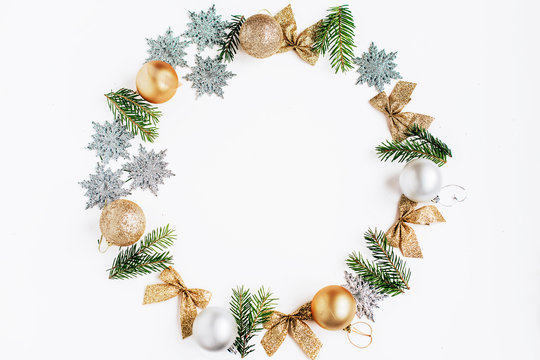 Christmas and New Year frame with golden and silver toys and fir branches